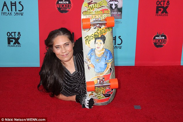 Red carpet: Rose used a skateboard to get around; she is seen at the Chinese Theatre in Hollywood last year