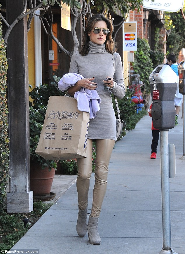 Covered up: The 34-year-old model stylishly wrapped up on the one day a year it's chilly in Los Angeles, flaunting her slim figure in a skintight ensemble at Brentwood Country Mart