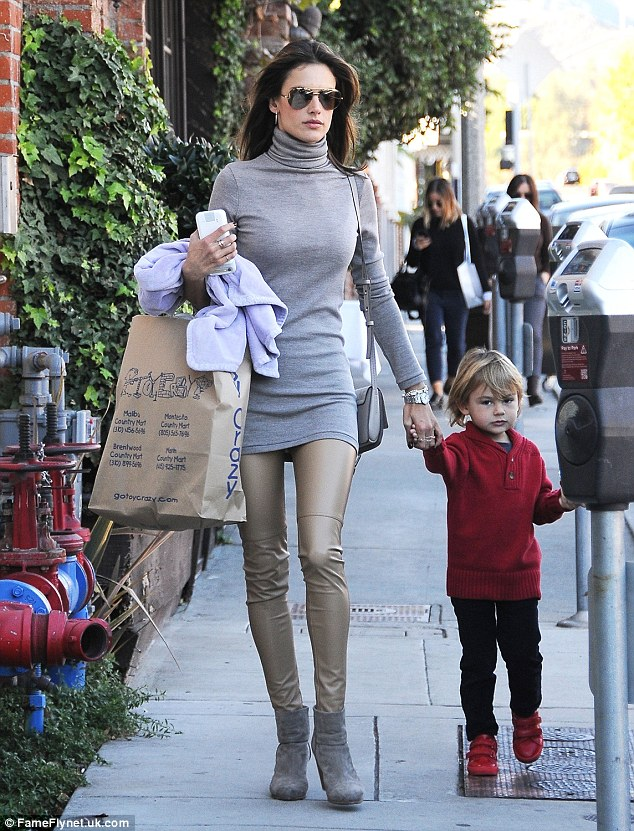 Gift shopping? The busy mother-of-two stepped out with her young son Noah, three, who looked ready for the holidays in seasonal red