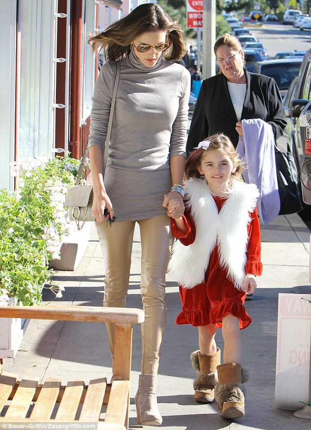 Santa's little helper: Alessandra's daughter Anja was wearing an even more festive red and white outfit