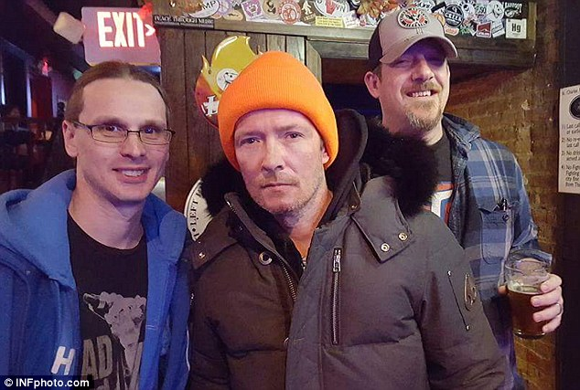 Battled addiction: Scott Weiland was pictured with fans at a bar ahead of his November 20 concert with The Wildabouts in Elmwood, Illinois. Eyewitnesses said he'd been drinking what looked like vodka before the show