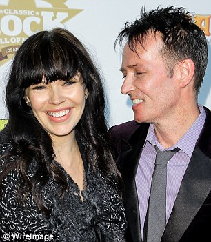 Weiland's wife, Jamie Weiland (left),  confirmed his death, telling a newspaper: 'I can't deal with this right now.' The pair are pictured here at the 2014 Classic Rock And Roll Honour Award Ceremony at Avalon, Hollywood
