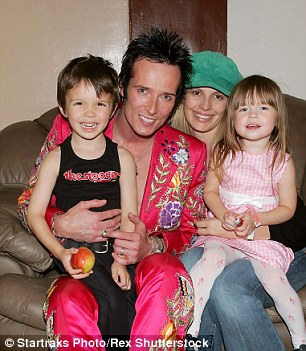 Above, Weiland sits with children Noah and Lucy and his second wife Mary Forsberg in 2005