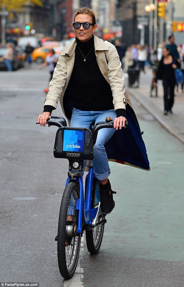 Time for a ride: Karlie Kloss decided to bike when she stepped out in New York on Saturday