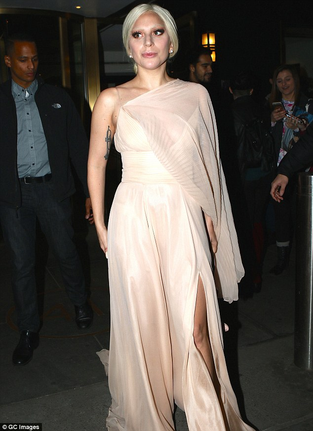 Great heights: The six-time Grammy winner rocked a flesh-flashing high split in the sheer and silk gown, which reached the ground despite her vertiginous platform shoes