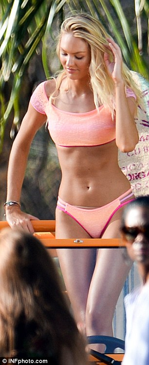 Pert derrière: The South African stunner looked typically tanned and taut in the cheeky two-piece thanks, in part, to her trainer - ModelFit's Justin Gelband