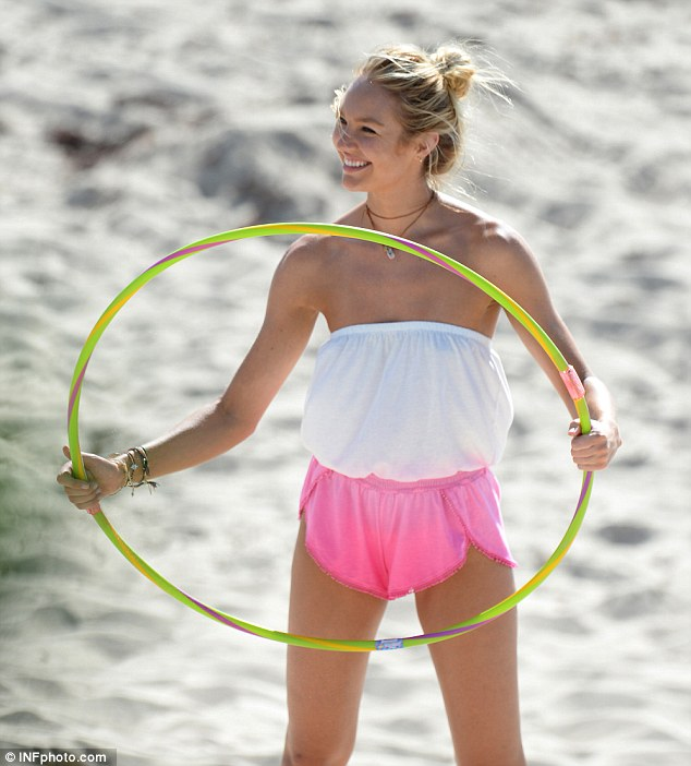 Natural beauty: Swanepoel - who also fronts Juicy Couture - was her usual effervescent self on the sand soaking up the sunshine