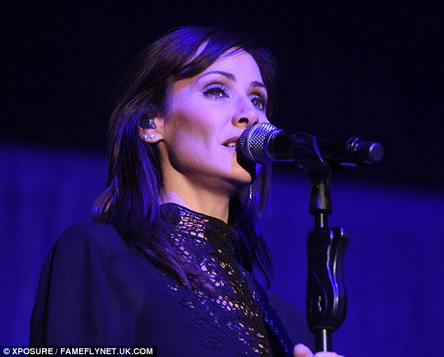 Hitting the high notes: Natalie was seen holding onto her microphone as she belted out the lyrics to some catchy tunes