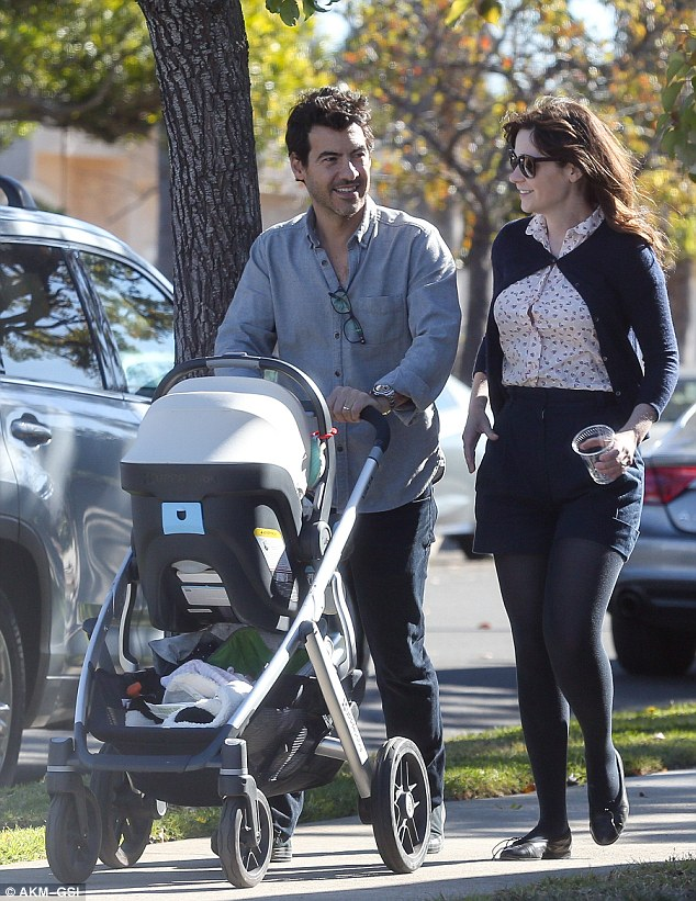 All smiles! Zooey Deschanel and her husband Jacob Pechenik beamed with delight as they strolled with newborn daughter Elsie Otter in Los Angeles Saturday