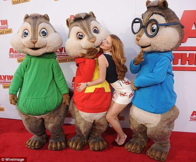 Getting up close and personal! Bella Thorne cosied up to Alvin the chipmunk at the premiere of Alvin And The Chipmunks: The Road Chip in Los Angeles on Saturday