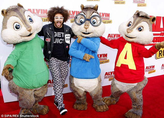 Party rocking: LMFAO's Redfoo looked like he was having a ball hanging out with the chipmunks
