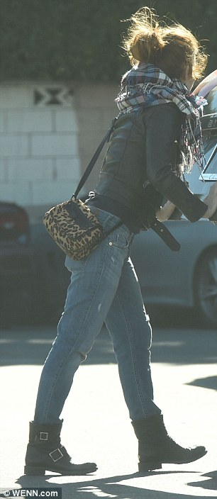 On the go:With her mobile phone and keys in hand, the movie star was seen leaving her black mini van in a parking lot
