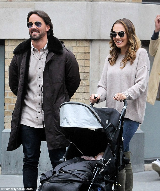 Laid-back:Jay, 34, looked equally stylish in a beige shirt, black jeans, brown parka, black leather boots and a pair of sunglasses