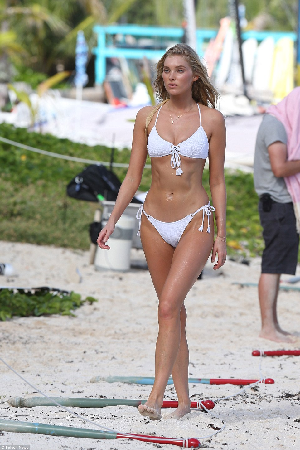 Beach babe: Elsa Hosk flaunted her incredible figure in a skimpy white bikini as she turned up the heat during a shoot for Victoria's Secret in St Barths