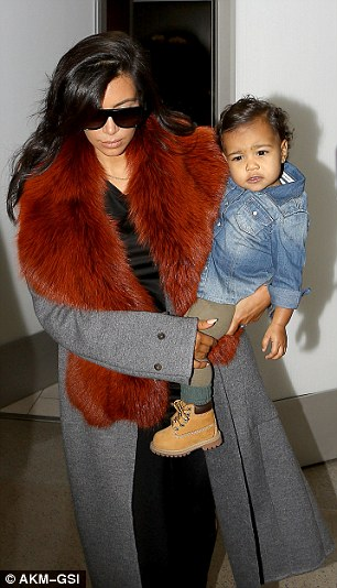 'I've saved up so many pieces from my closet!' The Selfish author once flew out of LAX with daughter North wearing this size 34 Celine grey overcoat featuring a real fur collar, which has amassed $4,050 from 60 bids