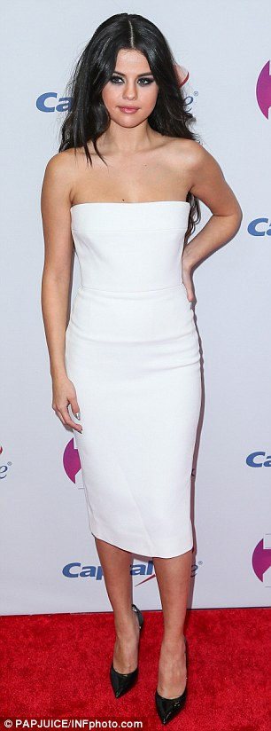 Opposites attract: While the 23-year-old donned practically all white, Demi went for an edgier approach with her leather skirt