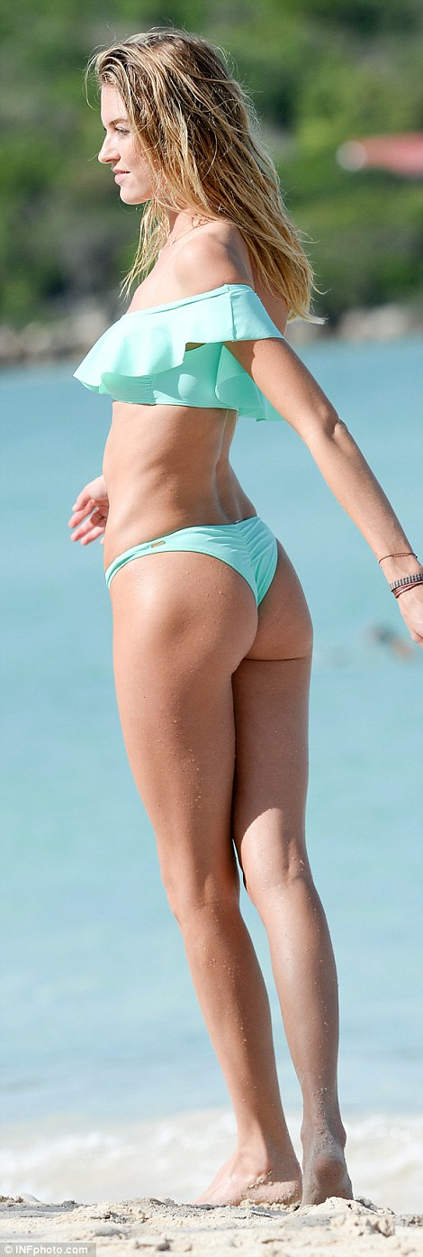 Twirl: As she span in front of the cameras, she revealed a thong design to her swimsuit