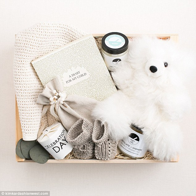 Thoughtful touch: The gift was complete with a plush white teddy bear, two crochet booties, and 'A Diary For My Child'