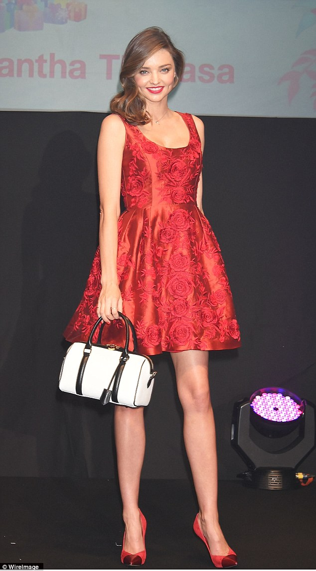 Legs eleven: Miranda Kerr showed off her long limbs as she took to the runway at an event in Tokyo, Japan on Saturday
