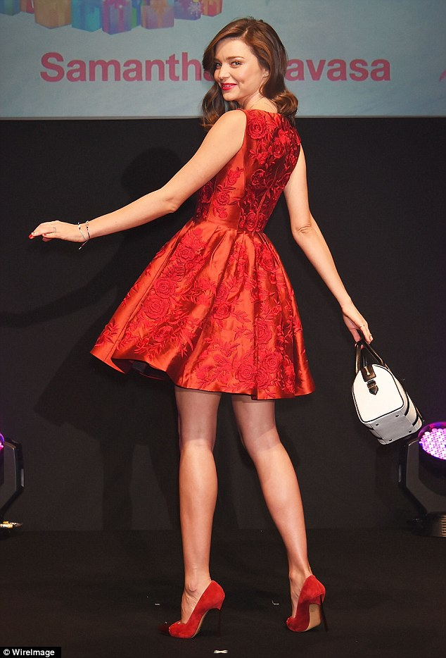 Bag lady:Miranda toted a monochrome bag from the popular Japanese brand as she walked down the stage