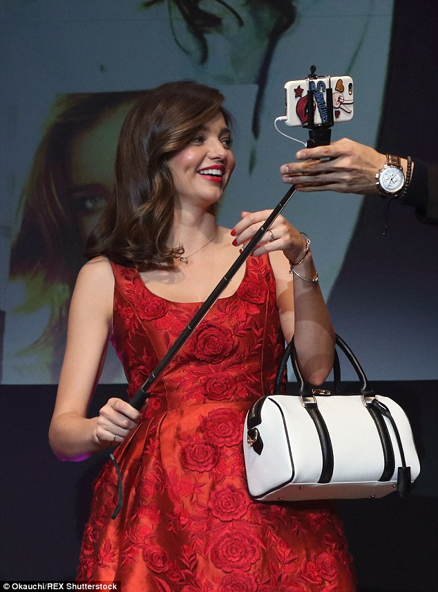 Photo time: Miranda was handed a selfie stick to take a snap with