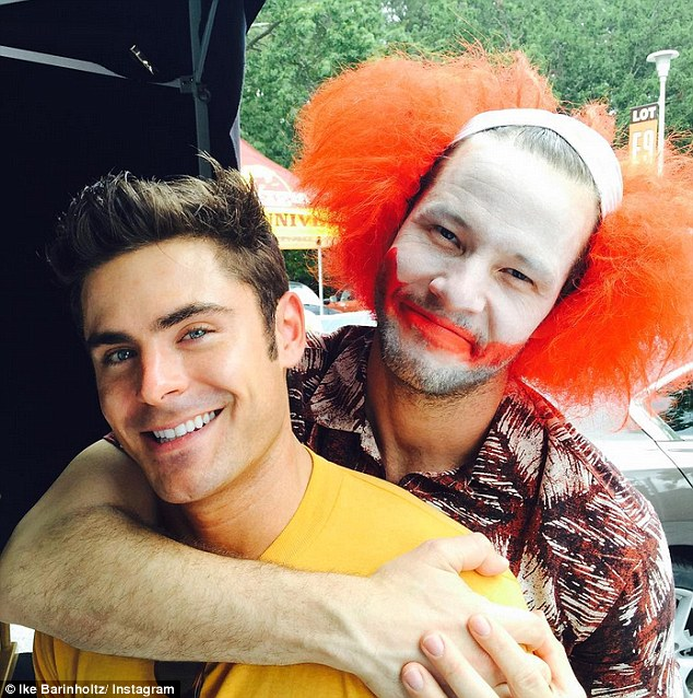 Fun and games: While on the Neighbors 2: Sorority Rising set, the star, dressed as a clown, posed for an Instagram photo with Zac Efron, captioning it:'So good to catch up with my son'