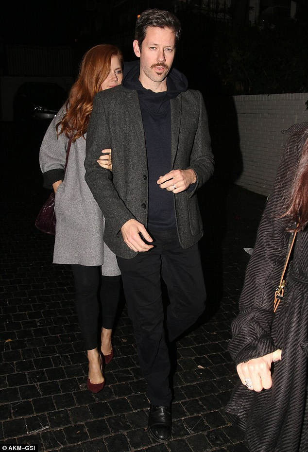 He's got style! Amy's hunky actor husband, Le Gallo added a polished look to his laid back look with a fitted charcoal grey blazer and black leather shoes