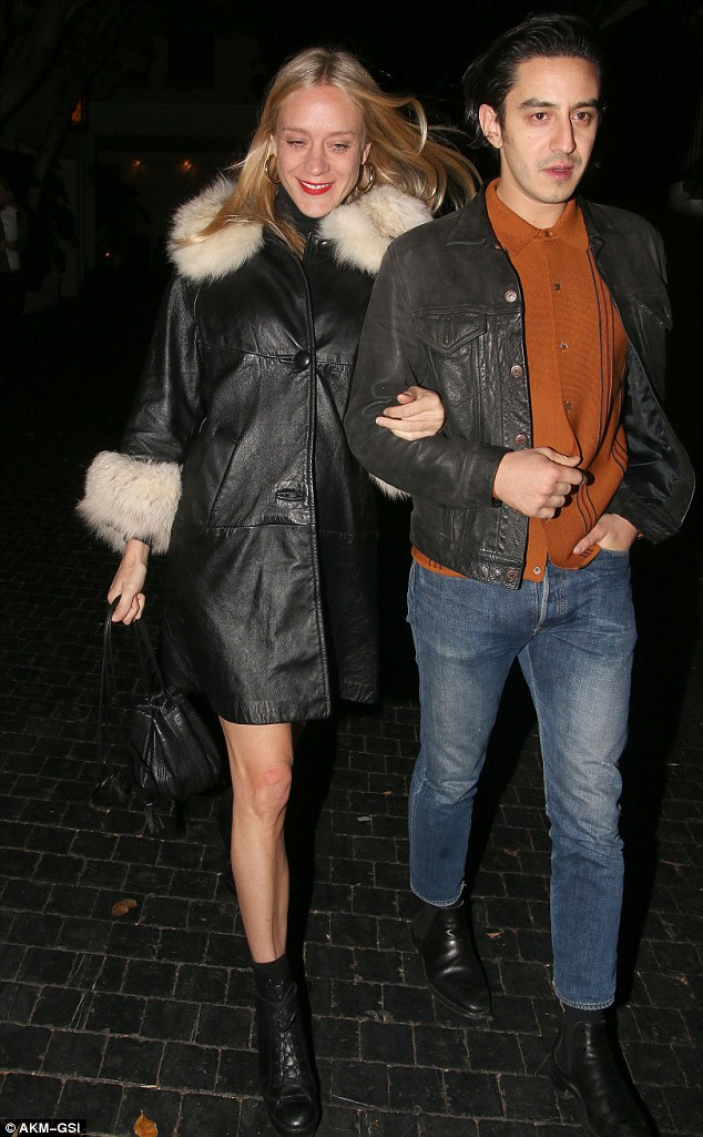 Rocker chic! Chloë Sevigny went with a 1970s-inspired wardrobe in a thigh-high black leather coat with cream fur trim which showed off her sculpted stems as she left the celebrity hot spot