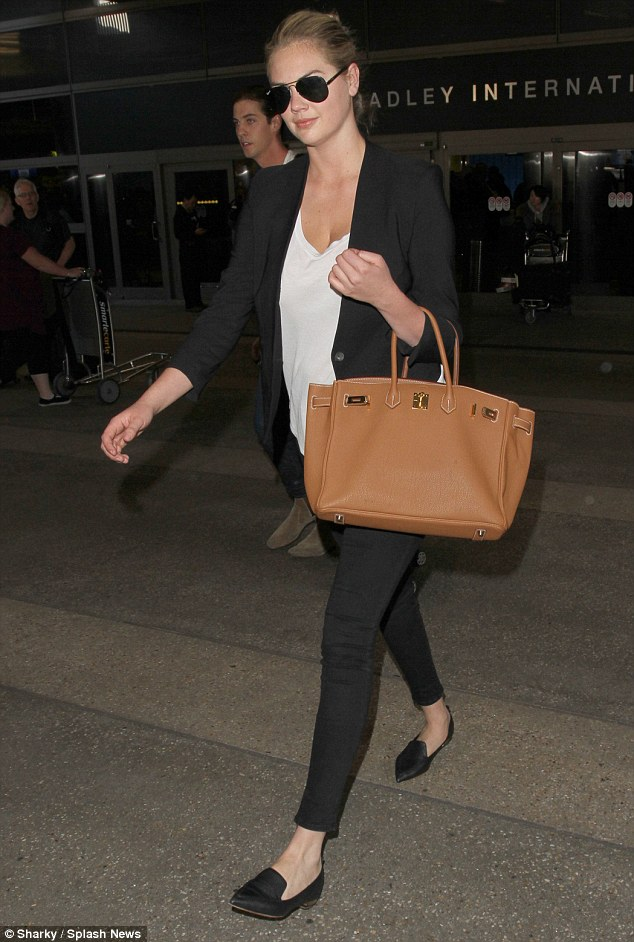 Fashionable arrival: Kate Upton touched down at LAX wearing a chic blazer and flat shoes on Friday