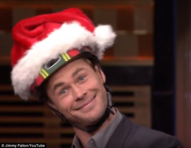 'Any opportunity to make a Hemsworth brother look less attractive': For the race, Chris, 32, was coaxed into wearing a  gimmicky Santa helmet which Jimmy pointed out was specifically chosen to embarrass him