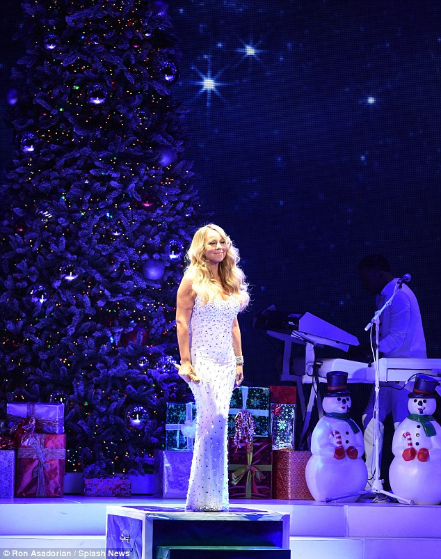 Sparkling star: The blonde looked sensational in her ballgown when she hit the stage