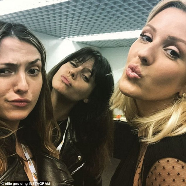 'My loves': Ellie took to Instagram to share a snap of herself and two pals backstage at the awards