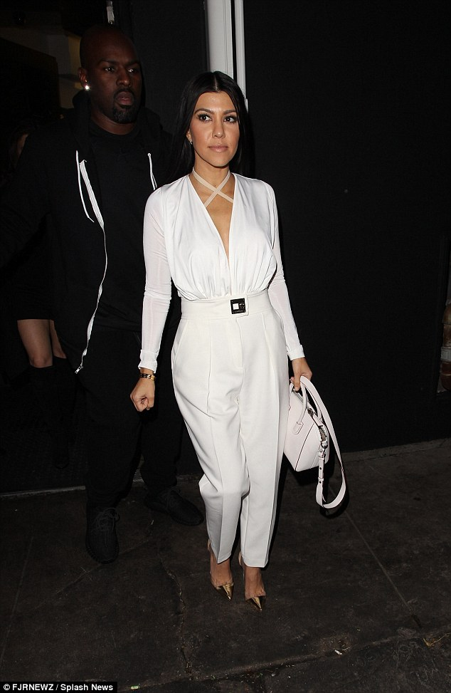 On the tiles:The 36-year-old reality star paired a ruched white leotard with a pair of high-waisted, tapered trousers for her star-studded evening at the A-list eatery