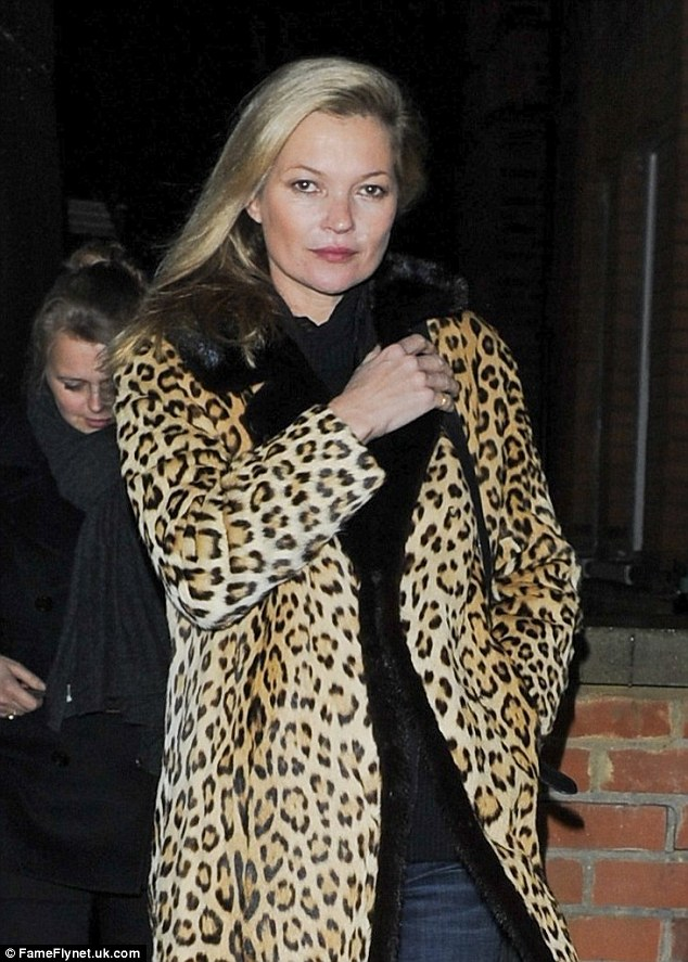 Chilled out:Kate Moss appears to be winding down with age as she dedicated her Friday night to walking her Staffordshire Bull Terrier cross Archie alongside her assistant Fiona Young