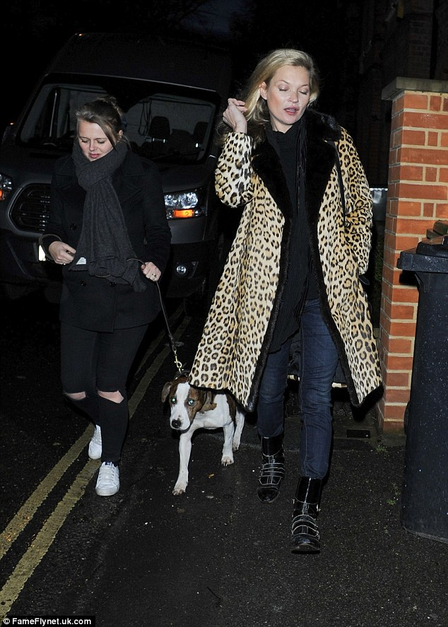 Bonding time:The 41-year-old supermodel looked sensational in her favoured leopard print coat look as she enjoyed some downtime with her aide and pup