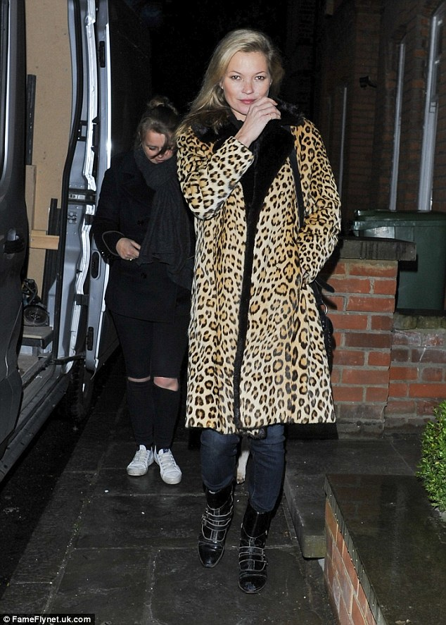 Lovely in leopard:Kate kept things low-key although still managed to ooze high-fashion attitude in her favourite-style of garment - a leopard print coat