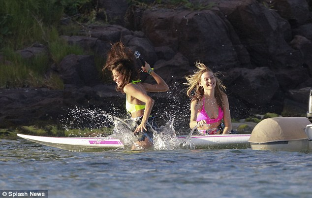 Splish splash: The duo couldn't hide their smiles as they splashed around in the water