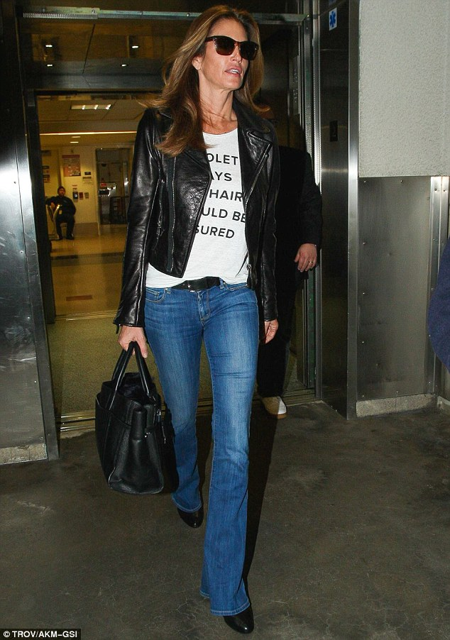 Fine wine: The ageing supermodel was looking almost as good as ever as she headed off to her next stop