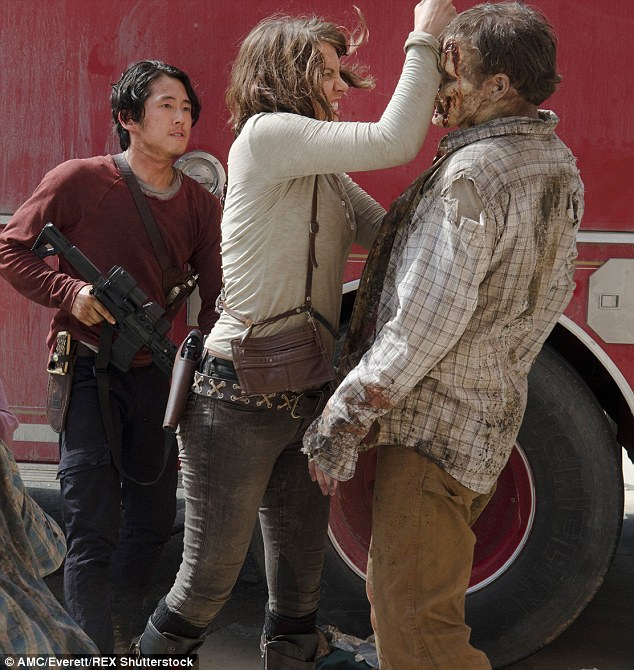 Happy couple: Her on-screen husband Glenn - played by Steven Yeun - meanwhile sent followers of the series into a panic when he appeared to be eaten alive by walkers.
