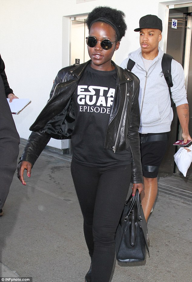 Stylish: Lupita accessorized her laid-back look with a black headband, over-sized sunglasses, and a black leather handbag