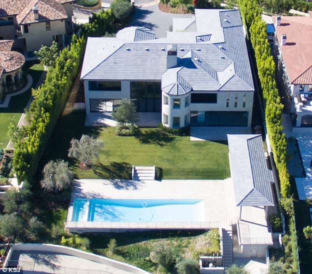 More is more: The Bel Air pad they bought in 2013 for £7 million was sold for nearly double that after renovation because the five-bedroom mansion with pool  wasn't up to the couple's high standards