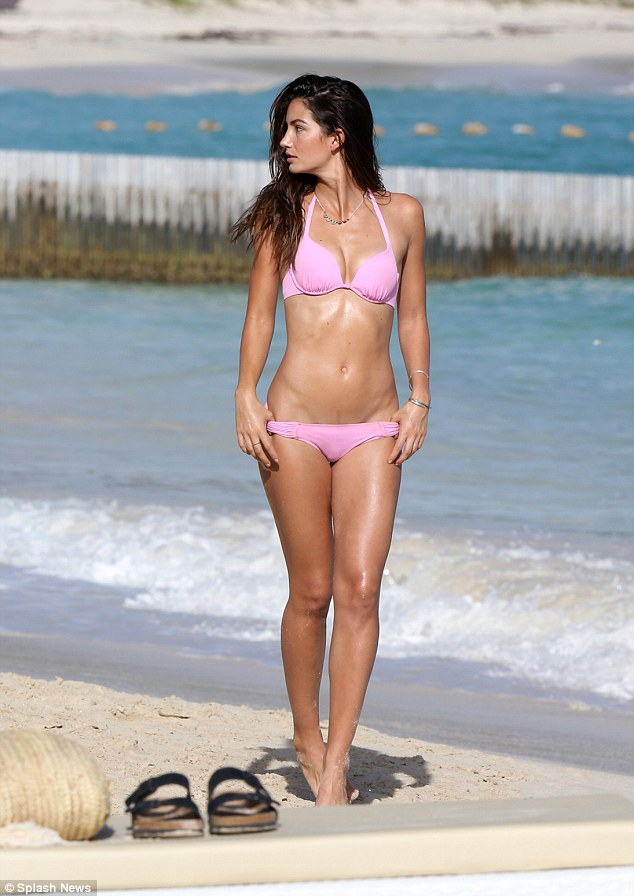 Tanned and toned: Lily's two-piece swimsuit highlighted her olive skin tone and rock-hard abs