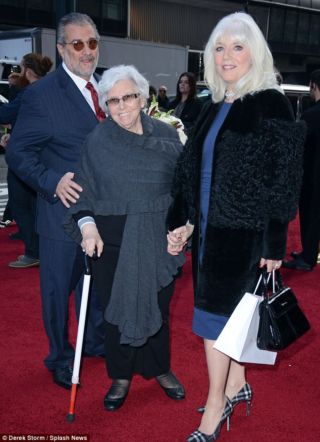 Family affair: The singer's parents Cynthia and Joe were there to support the star as well as grandmother Angelina