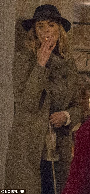 36-year-old TV presenter Donna braved the winter chill to step out of the bar for a cigarette