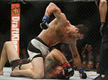 Luke Rockhold, above, fights Chris Weidman in a middleweight championship mixed martial arts bout at UFC 194, Saturday, Dec. 12, 2015, in Las Vegas. (AP Photo/John Locher)