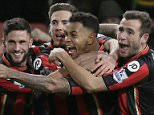 Bournemouthís Joshua King, centre, celebrates after scoring a goal during the English Premier League soccer match between Bournemouth and Manchester United at the Vitality Stadium in Bournemouth, England, Saturday Dec. 12, 2015. (AP Photo/Tim Ireland)