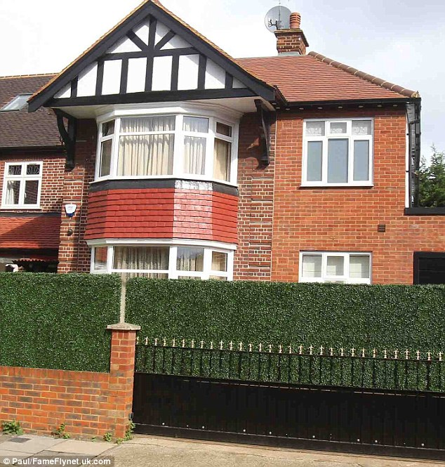 Raid: Jewellery, cash and electrical goods are understood to have been taken when thieves broke in to the singer's six-bedroom semi-detached house, pictured, in the early hours of November 28