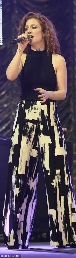 Quirky: Jess' full outfit - including chunky platform heels - was visible when she took to the stage