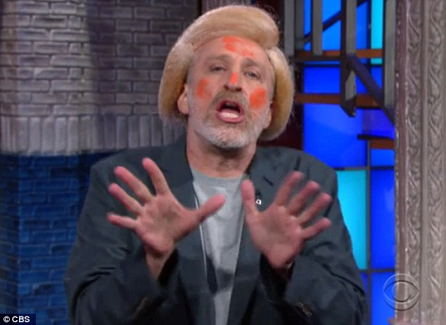 Impression: Jon Stewart donned a blond wig and and Cheetos dust to give a hilarious Trump impression during an appearance on the Late Show with Stephen Colbert on Thursday