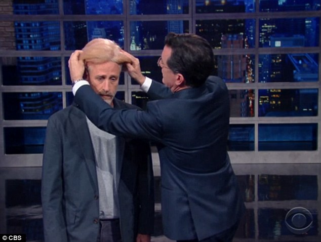 Trump it up: Colbert made up Stewart to look like Colbert, saying 'The media won't pay attention to anything at all, unless you are Donald Trump'